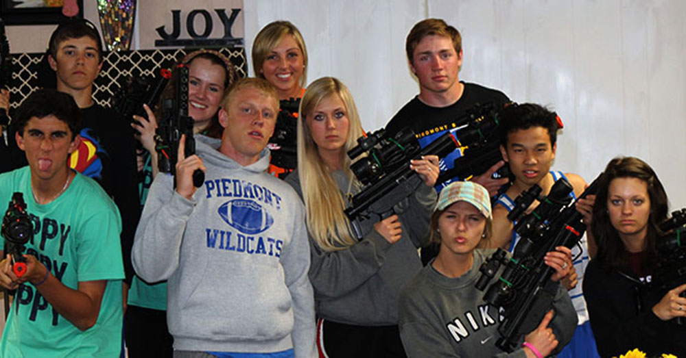 Group of campers ready to play laser tag.