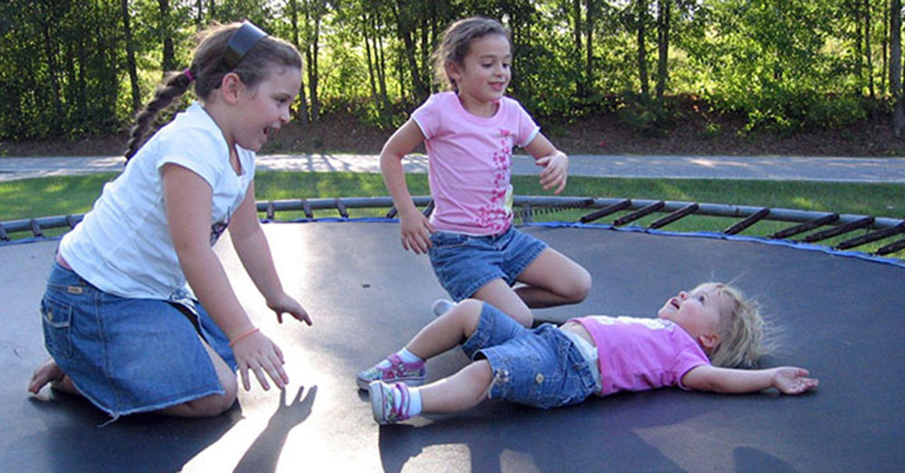 Kids Playing on a Trampoline